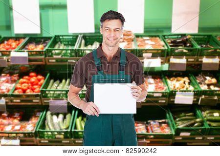 Male Gardener Holding Blank Placard
