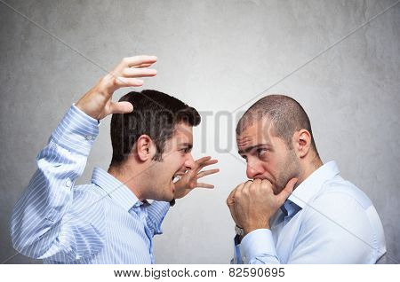 Angry man shouting to another man