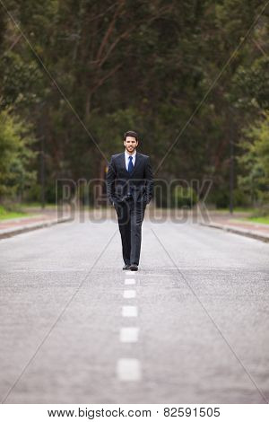 Businessman walking on the road line