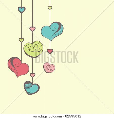 Elegant greeting card design with colorful hanging hearts for Happy Valentines Day celebration.