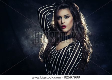 young beautiful woman with long dark hair,  red lipstick , wearing black and white striped shirt with collar