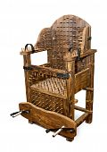 stock photo of torture  - The ancient armchair for tortures isolated with clipping path - JPG