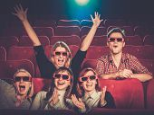 pic of watching movie  - Group of people in 3D glasses watching movie in cinema - JPG