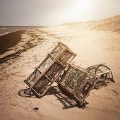 foto of lobster trap  - Three lobster traps on Atlantic ocean beach in Prince Edward Island - JPG