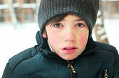 stock photo of crying boy  - preteen boy cry frustrated after tearing his jacket - JPG