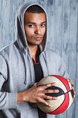 foto of basketball  - Image of fit young afro american athlete holding a basketball looking away with copyspace - JPG