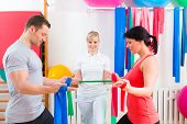 pic of physical therapist  - Patients at the physiotherapy doing physical exercises with therapist - JPG