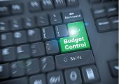 stock photo of budget  - 3d rendering of black computer keyboard with green enter button of words budget control - JPG