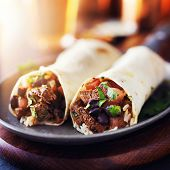 stock photo of mexican  - mexican beef steak burritos with black beans - JPG
