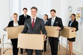 picture of employee  - Portrait Of Happy Multiethnic Employees In Office Holding Cardboard Boxes
