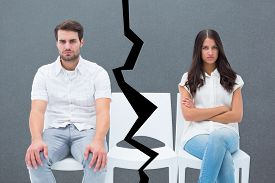 stock photo of not talking  - Angry couple not talking after argument against grey - JPG