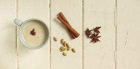 stock photo of cardamom  - Top view of a chai tea with cinnamon - JPG