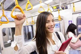stock photo of commutator  - Subway commuter woman on Japanese public transport in Tokyo - JPG