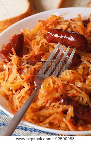 Stewed Cabbage With Sausage Macro In A White Plate. Vertical