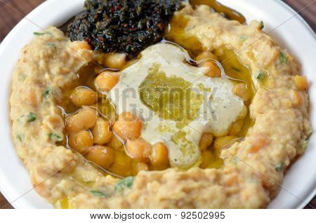 Israeli Hummus With Olive Oil, Herbs, And Spices