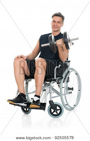 Disabled Man On Wheelchair Working Out With Dumbbell