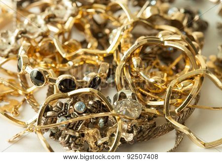 Heap of golden and silver decorations and jewels