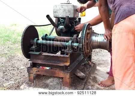Select Focus Of Working Men Repair An Engine