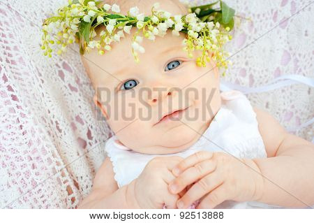 cute baby and flower lily of the valley