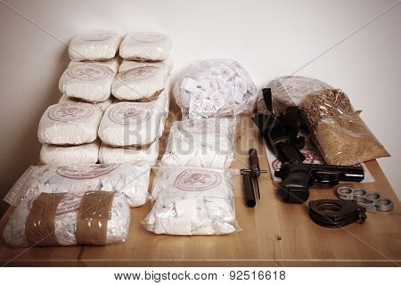 Seized drugs and weapons of dealers