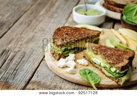Grilled Rye Sandwiches With Cheese, Spinach, Pesto, Avocado And Goat Cheese