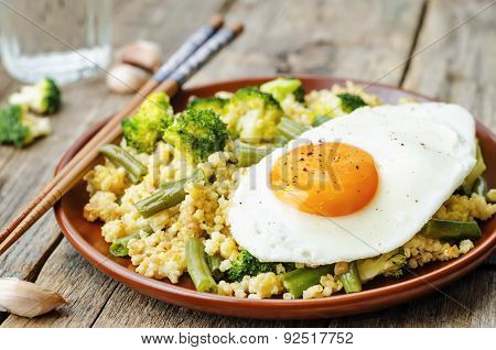 Stir Fried Millet With Broccoli, Green Beans And Fried Egg