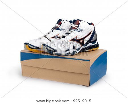 Sneakers On Shoe Cardboard Box Isolated On White Background