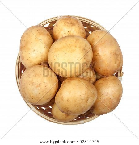 New Potatoes In A Light Basket On An Isolated White Background