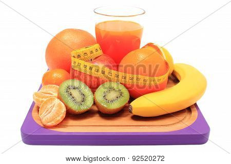 Fresh Fruits, Tape Measure And Glass Of Juice