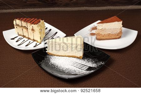 Tiramisu And Chocolate Cheesecake On A Dark Background