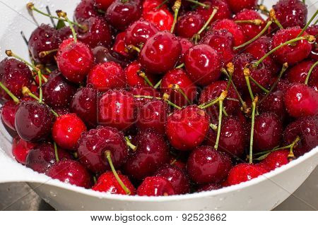 Background Of Close Up Ripe Cherries With Water Drops