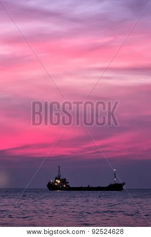 Cargo Ship In South China Sea At Dusk, Vietnam