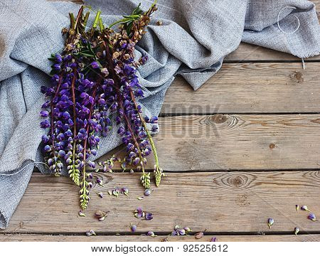 lupine on background of burlap and in Wooden floor.