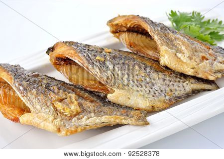 Fried Tilapia Fish On Plate With White Background