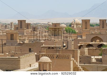 View to the roofs of the old brick buildings with badgirs (wind catching towers) in Yazd, Iran.