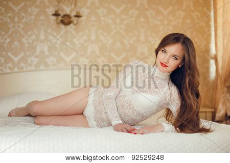 Beauty Bride Portrait Of Young Beautiful Sexy Woman With Long Wavy Hair. Pretty Girl Lying On The Be
