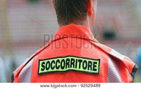 Italian Doctor With Orange Uniform In The Stadium