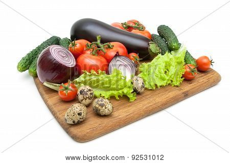 Fresh Vegetables And Quail Eggs On A Cutting Board On A White Background