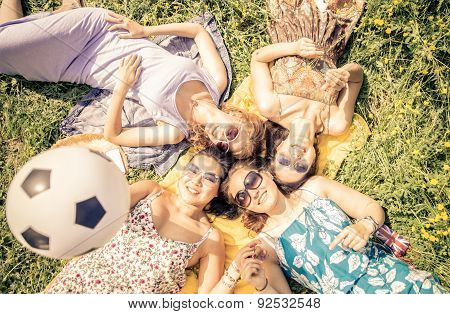 Four Friends Lying In The Grass