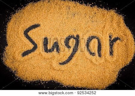 Word Sugar Written In Brown Granulated Sugar