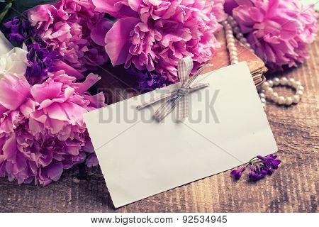 Splendid Peonies Flowers On Vintage Background.