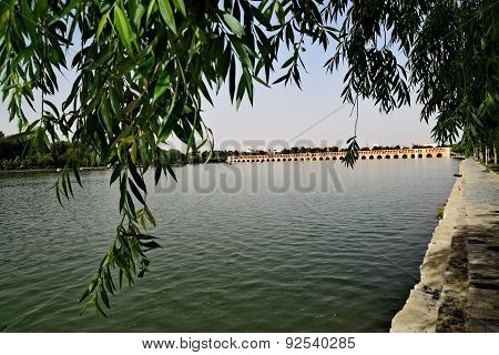 View from Siosepol with trees, Sio-se Bridge in Esfahan, Iran