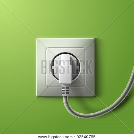 Realistic electric white socket and plug on green wall backgroun