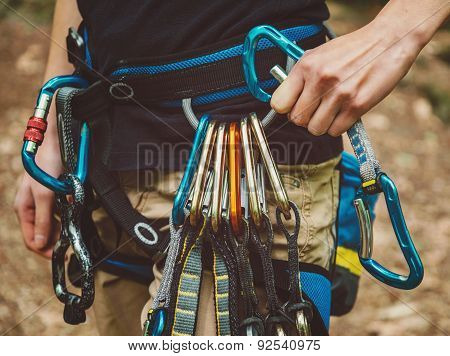 Female Rock Climber Wearing Safety Harness
