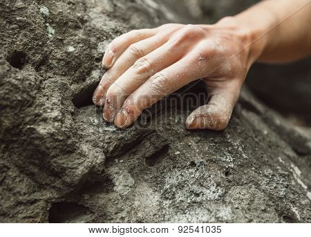 Close-up Of Climber Hand On Rock