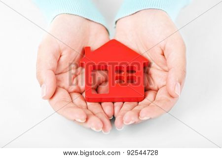 Female hands holding house, closeup