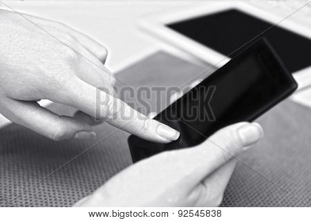 Woman with mobile phone and tablet, close-up