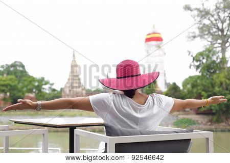 Asian Woman Stretching Her Arms On Her Vacation