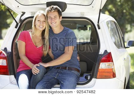 Couple Sitting In Trunk Of Car