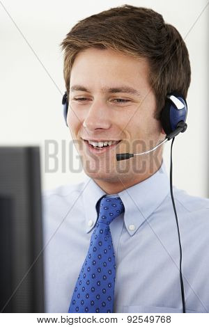 Friendly Service Agent Talking To Customer In Call Centre